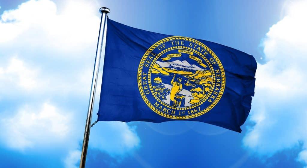 nebraska flag, 3D rendering, on a cloud background